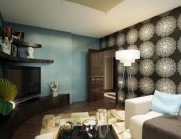 При всей своей сдержанности интерьер гостиной получился стильным и живым, располагающим к приятному времяпрепровождению