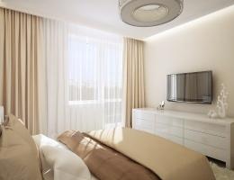 Одно из украшений спальни — широкие кремовые шторы в комбинации с ослепительно-белым тюлем. Благодаря такому выбору, комната кажется светлее, уютнее, больше