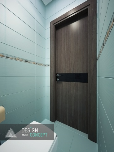 С тепло-коричневым оттенком бордюров и панно перекликается цвет двери, которая ведет в холл