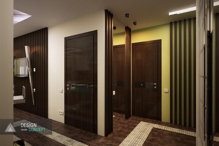 Холл и кухню объединяет широкий открытый вход без дверей. Подобное решение призвано визуально увеличить площадь прихожей